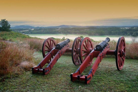 two old, historic canons overlooking cascading hills in Saratoga