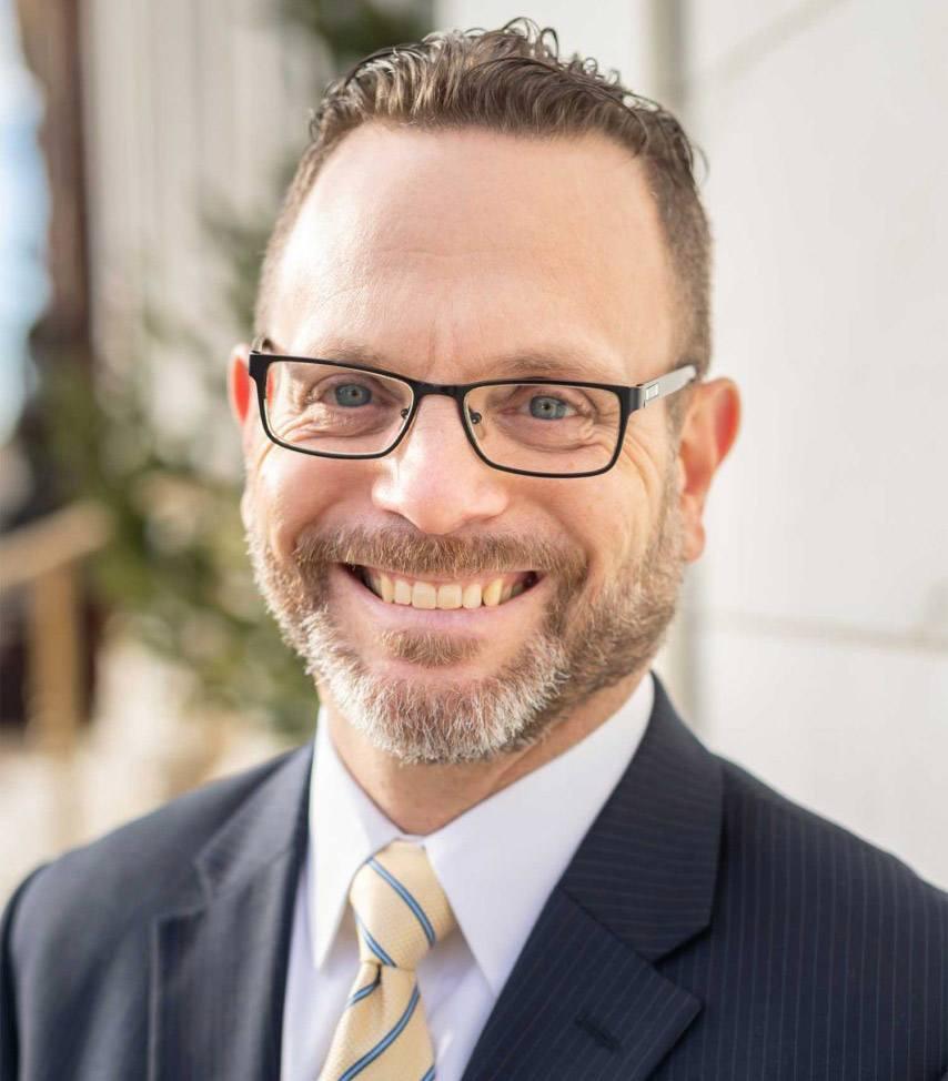 Lawrence Elmen smiling in headshot